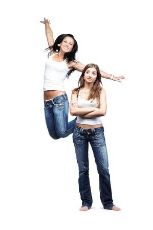 two emotional girls, isolated on white photo