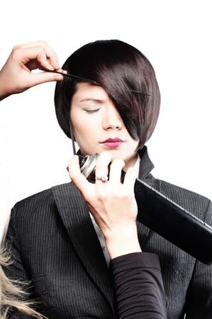 Fixing model�s hair photo