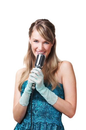 Pretty young girl singing into retro microphone, isolated on white Stock Photo - 4270693