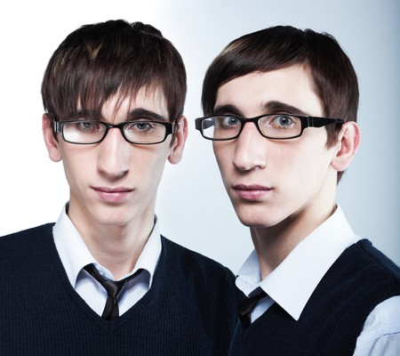 haircuts: cute young twins with fashion haircuts wearing glasses