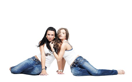 two girlfriends wearing blue jeans isolated on white with copy space photo