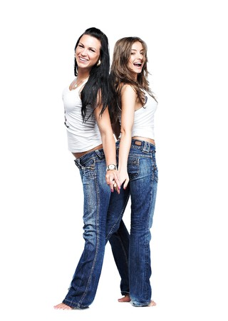two girlfriends wearing blue jeans on white photo