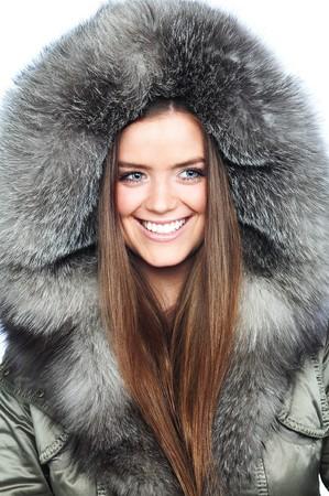 Beautiful girl wearing fur coat photo