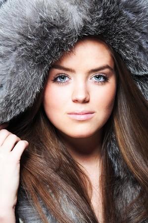 Beautiful girl wearing furs photo