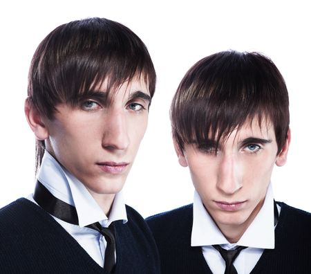 haircuts: Young twins with fashion haircuts isolated on white