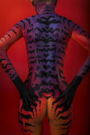 Closeup back of female model with body art - cat Stock Photo - 4858609