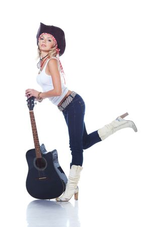 Cow-girl holding an acoustic guitar, isolated on white photo