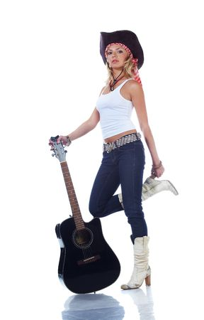 cowgirl boots: Cow-girl holding an acoustic guitar, isolated on white