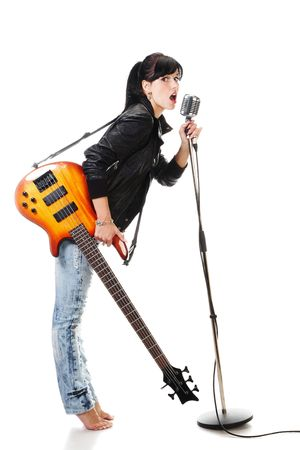 Rock-n-roll girl holding a guitar singing into retro microphone isolated on white Stock Photo - 5616954