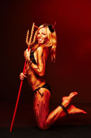 dirty blond: Beautiful devil with trident, Halloween Stock Photo