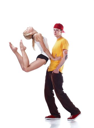 Young ballerina jumping and serious young hip hop dancer isolated on white background photo
