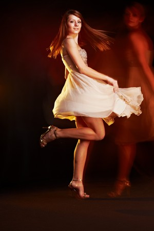 Beautiful young female wearing dress, dancing, multiple exposure non photoshoped montage. photo
