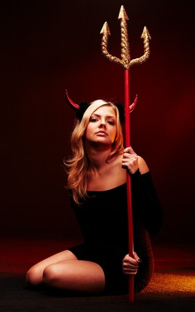 devil girl: Beautiful devil with trident on black