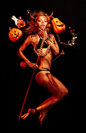 dirty blond: Beautiful devil with trident and Halloween accessories on black Stock Photo