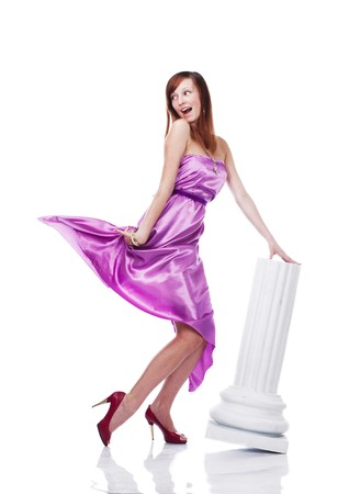 Young beautiful female wearing lilac dress, flirting, isolated on white photo