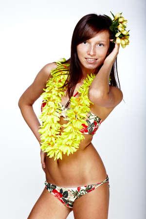 Beautiful exotic girl with Hawaiian accessories photo
