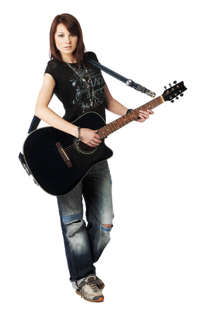 sexy guitar: Teenager girl playing an acoustic guitar, isolated on white