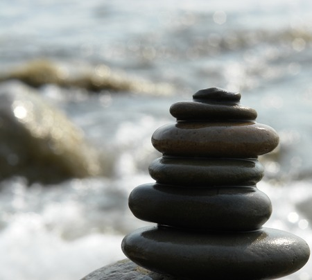 The pyramid of stones on sea coast                                 photo