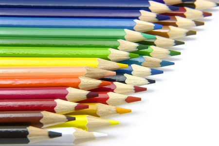 Two rows of coloured pencils on the white background