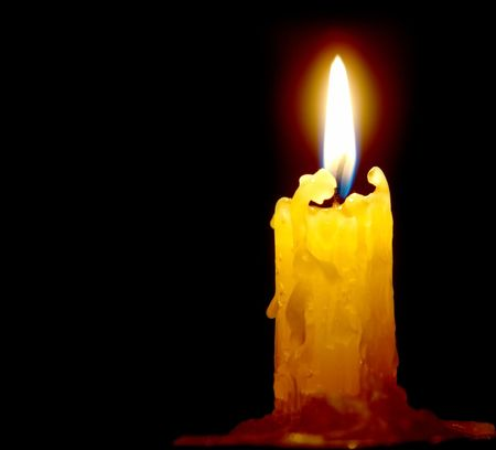 Candle light on the black background