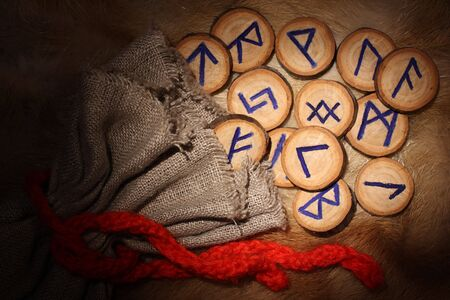fortunetelling: Handmade rune set with pouch, close-up