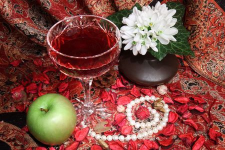 wine, apple and flowers, still life in medieval style photo