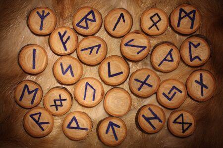 Handmade wooden rune set on the fur Stock Photo