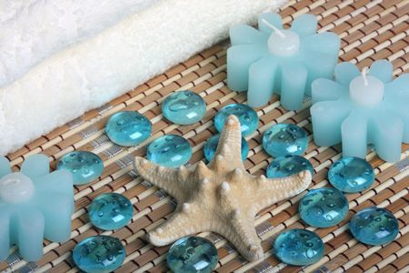 bath towels, candles, starfish and glass pebbles Stock Photo - 3123310