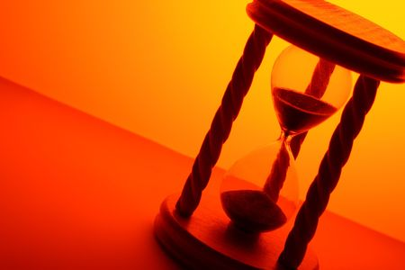 the ancient pass: hourglass in orange light Stock Photo