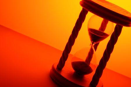 hourglass in orange light Stock Photo