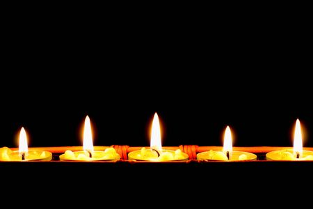 row of candles on black backgrounds Stock Photo - 3457868