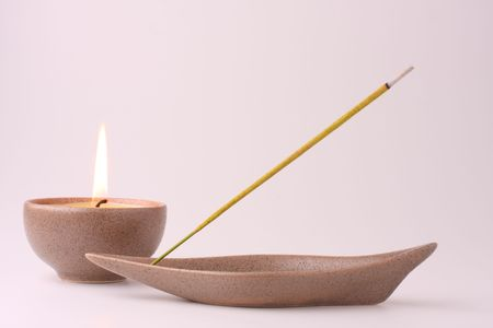 Still life with candle and incense stick in pastel shades photo