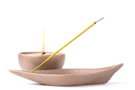 Candle and incense stick isolated on white background Stock Photo