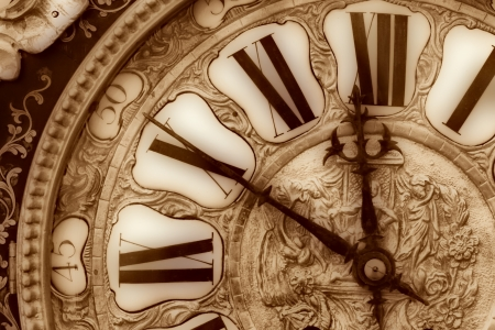 bronzy: Close-up of antique clock of the eighteen century Stock Photo