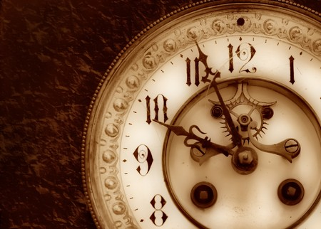epoch: Old clock on the relief background Stock Photo