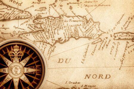 haiti: Compass on old handwritten map of Haiti