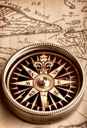 Compass on old handwritten map photo