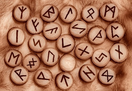 futhark: Runes on fur sepia toned Stock Photo