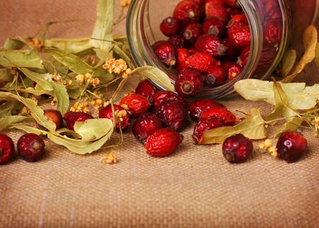 homoeopathic: Rose hips and dry lime blossom on sacking background
