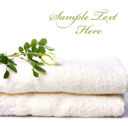 Bath towels with rose isolated on white  Stock Photo