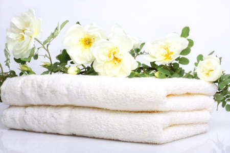 Bath towels with white rose Stock Photo