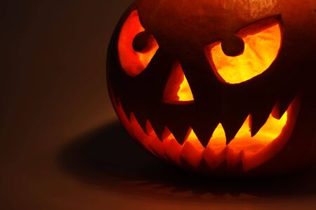 Halloween pumpkin on dark background photo