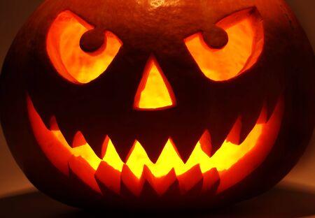 Halloween pumpkin in dark photo