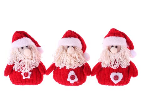 Three Santa Clauses isolated on white background photo