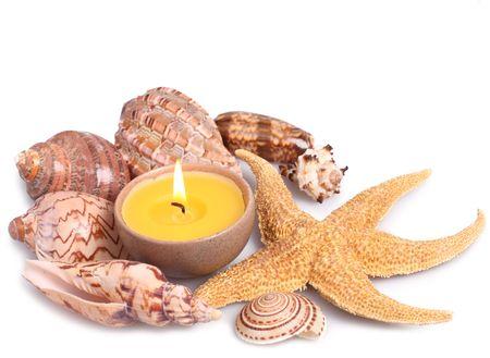 Seashells, starfish and candle isolated on white background Stock Photo