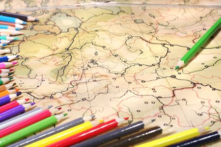 Color pencils on old contoured map, shallow DOF Stock Photo - 6757272