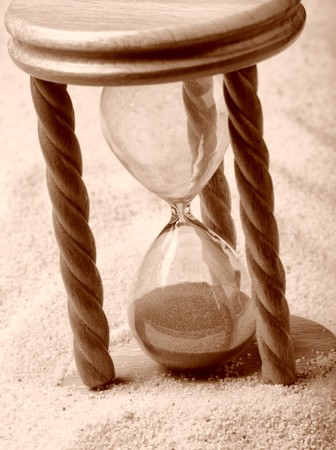 the ancient pass: Hourglass in sand, shallow depth of field