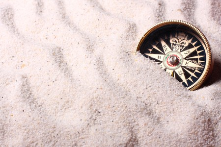 Compass in sand. Shallow depth of field - focus on the compass Stock Photo - 6948000