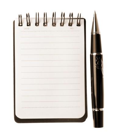 Notebook and pen isolated on white background, sepia toned Stock Photo