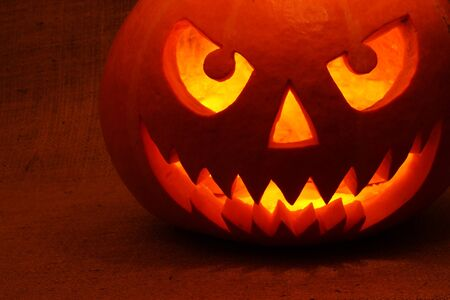 Halloween pumpkin in the dark photo